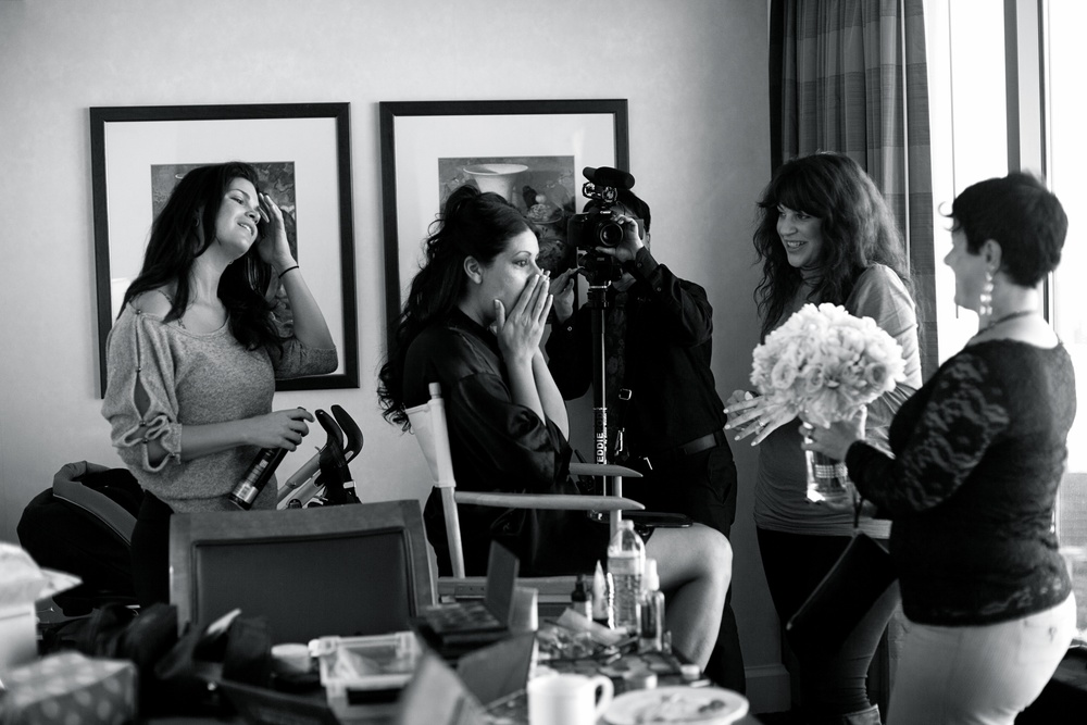 Bride seeing her bouquet for the first time - An Intimate Wedding at Four Seasons Las Vegas.