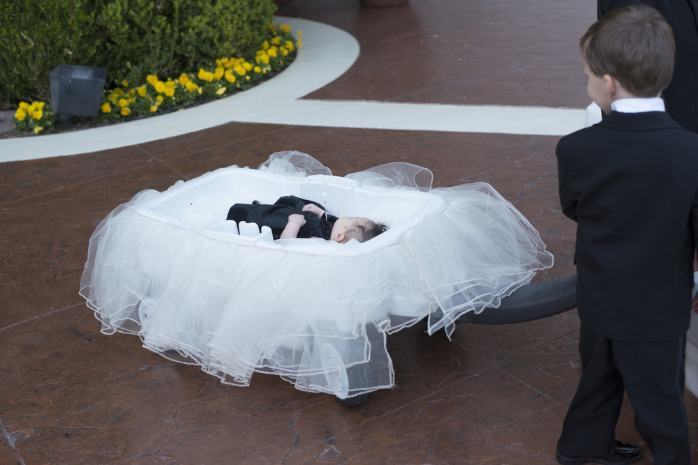 The baby girl was brought in by a tulle-covered wagon - An Intimate Wedding at Four Seasons Las Vegas.