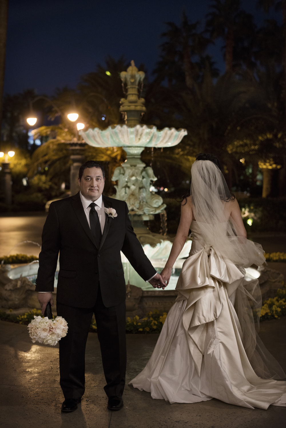 The back of the dress featured an oversized bow for extra drama - An Intimate Wedding at Four Seasons Las Vegas.