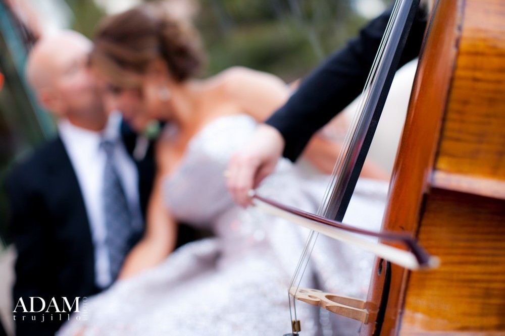 A cello serenades our couple during a private moment on the Juliet Balcony