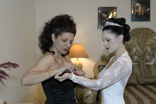 My mother helping my sister into her wedding dress.