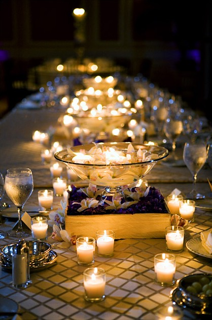 Votives add a gorgeous and playful touch to this table top.  Photo courtesy of Wedding Beginnings.