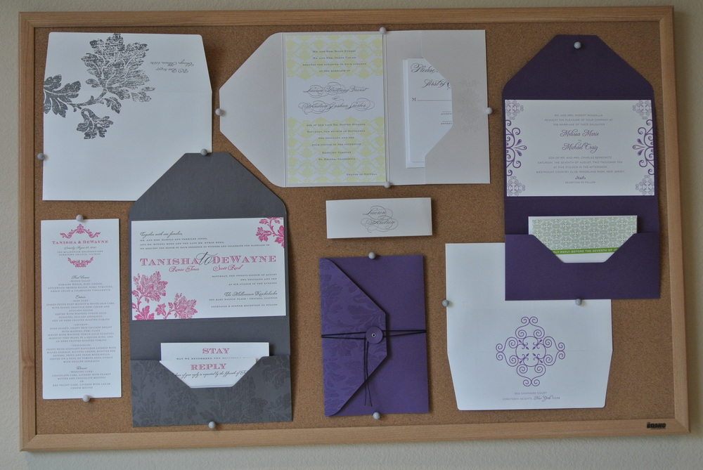A selection of custom wedding invitations hand proudly on the office wall.