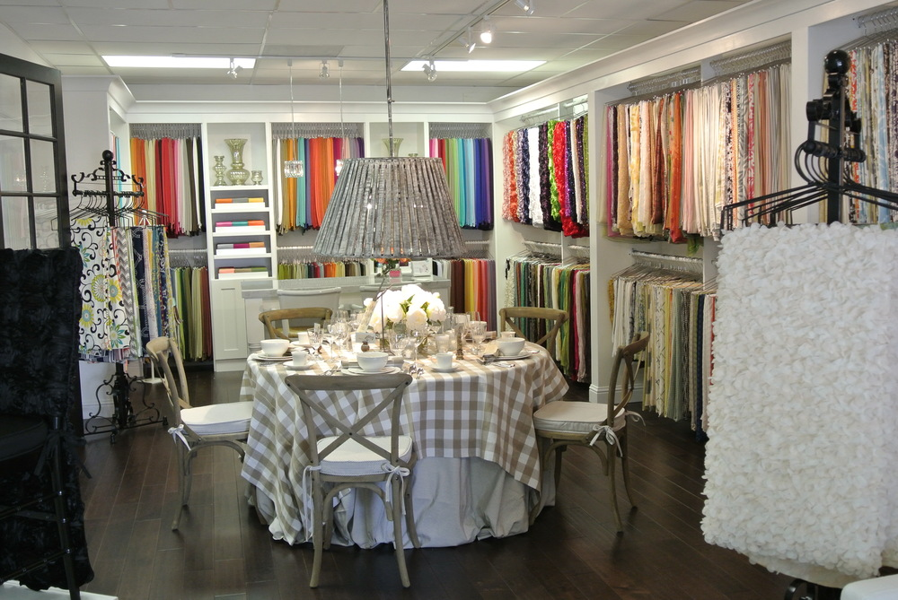 The stunningly elegant showroom of La Tavola - Your source for  upscale wedding linens.