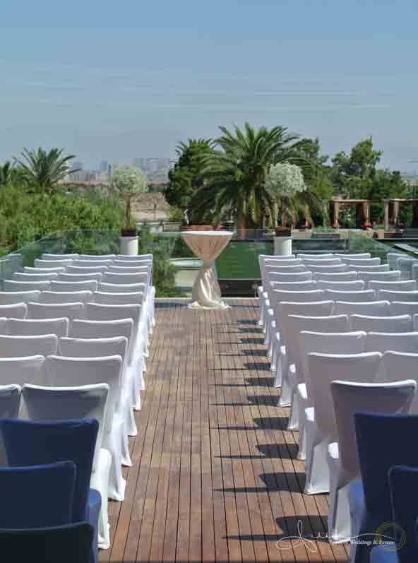 The ceremony was kept clean and elegant with white covered chairs. All that was needed to complete the scene were willow trees topped with babies breath.