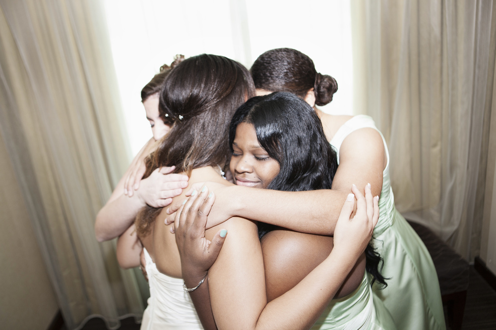 Bridesmaids gathered around Ashley to say a prayer before she said her vows.