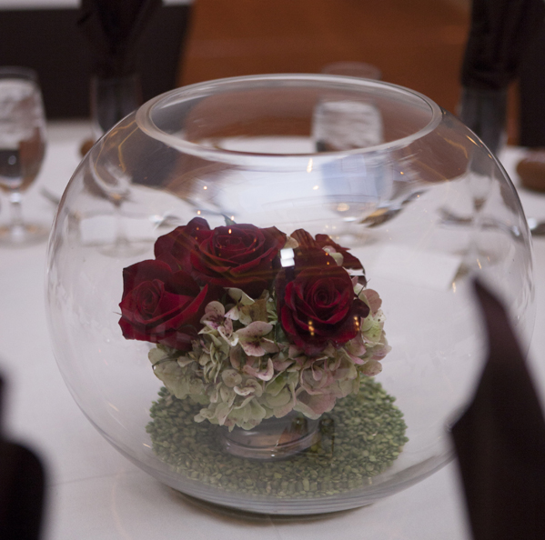 The small centerpieces were made of red roses and jade green hydrangea.  Photo by www.altf.com.