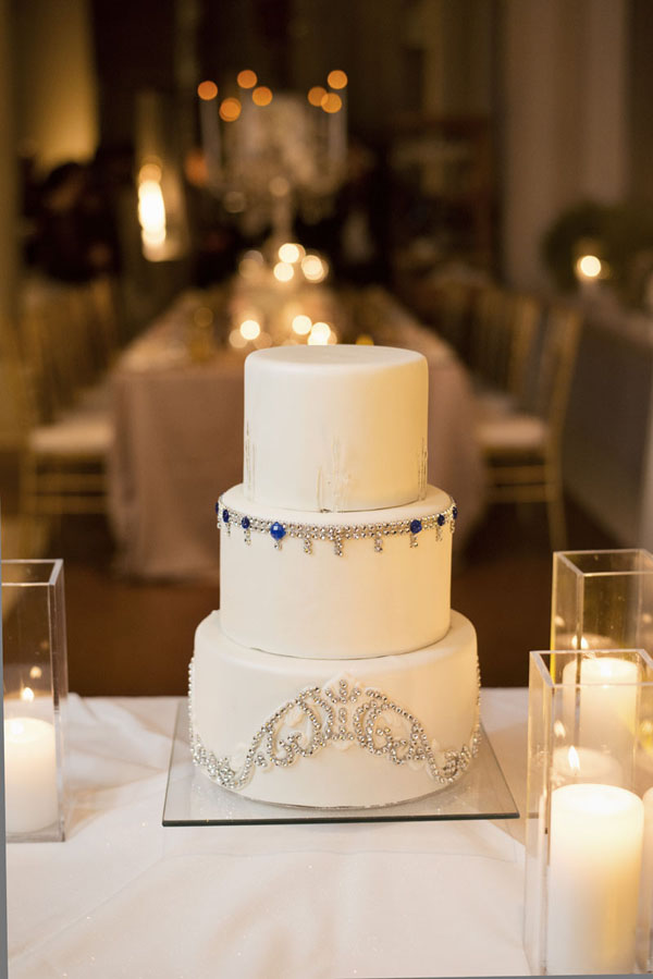 """Our wedding cake was a simply white fondant accented with crystals in alternating patterns. Note the sapphire crystals which represented my """"something blue."""" Wedding Cake by Four Seasons Las Vegas. Photo by www.altf.com."""