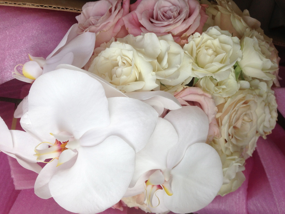 Orchids and roses for the bridal bouquet.  MORE Fox 5 Wedding Week.