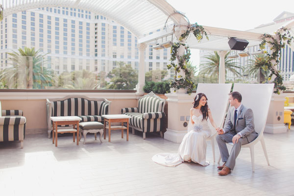 The Bride & Groom shared a moment before their wedding on the rooftop gardens of Chateau. Photo by Adam Trujillo.