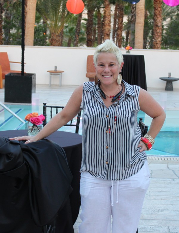 Randi of Naakiti Floral on site setting up the Breathe Pool for Jacki & Phil's Las Vegas Wedding! Photo by Brian Derck.