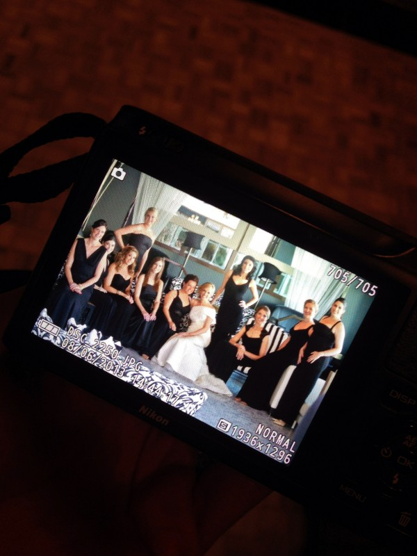 The bridesmaids all wore floor length black gowns they selected for themselves. Photo by Andrea Eppolito.