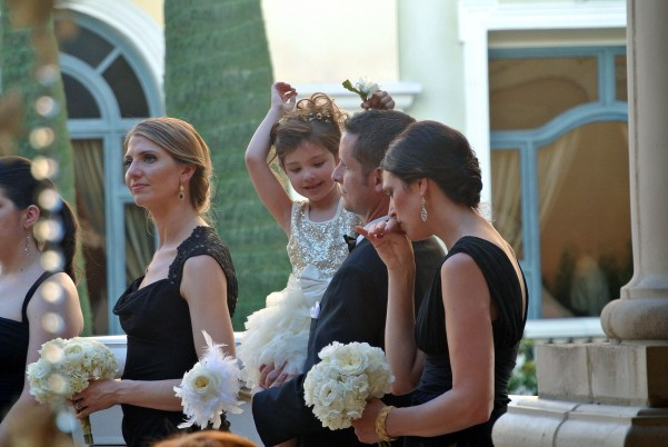 The adorable flower girl cheering in delight at the first kiss! Photo by Andrea Eppolito.