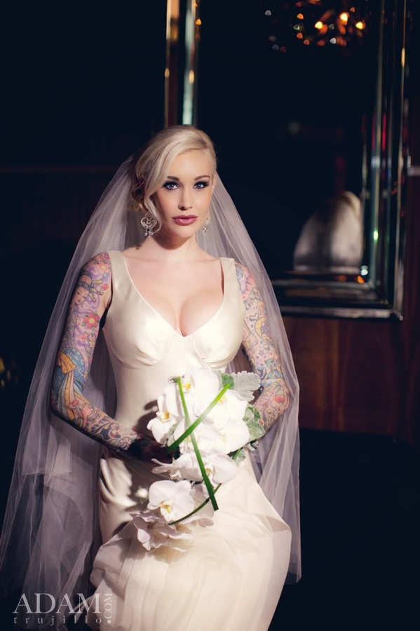 image shows Sabina Kelley, tattoos & vera wang gown