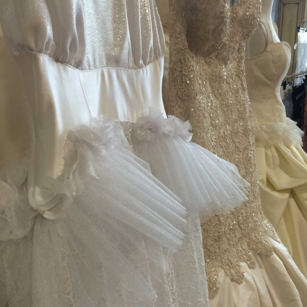Mina Olive creates one of a kind wedding dresses here in Las Vegas. The showroom, located in Tivoli, handles the design, fabric selection, construction, and alterations. They even creat veils, belts, and accessories!