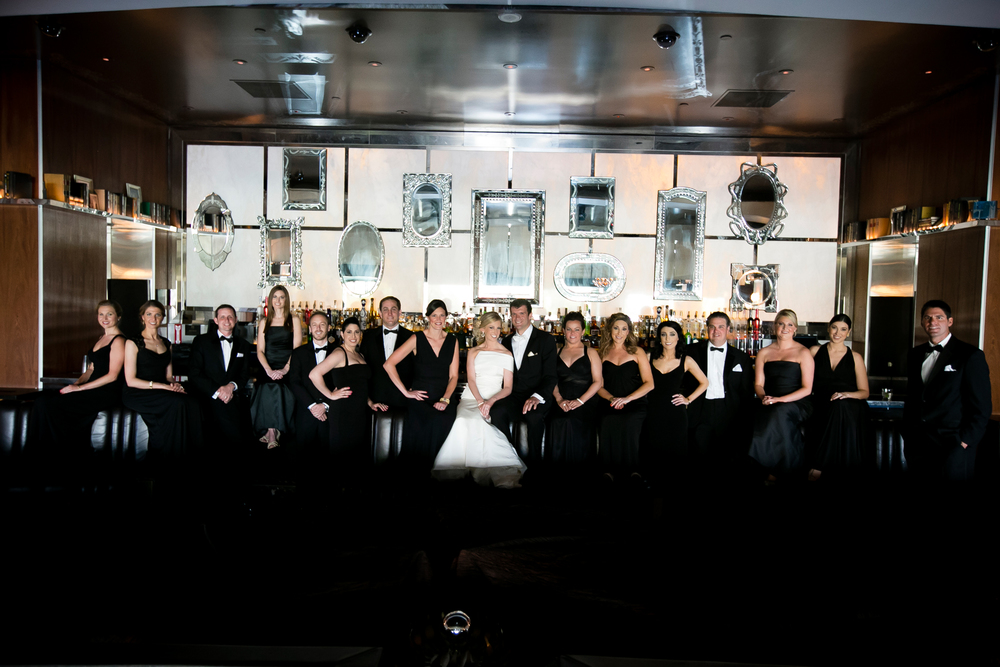 The large bridal party required something dramatic for formal portraits.  Wedding Venue:  Bellagio Las Vegas.   Location:  Hyde Bellagio .  Photo by  www.ronmiller.com .  Las Vegas Wedding Planner:  Andrea Eppolito Events .