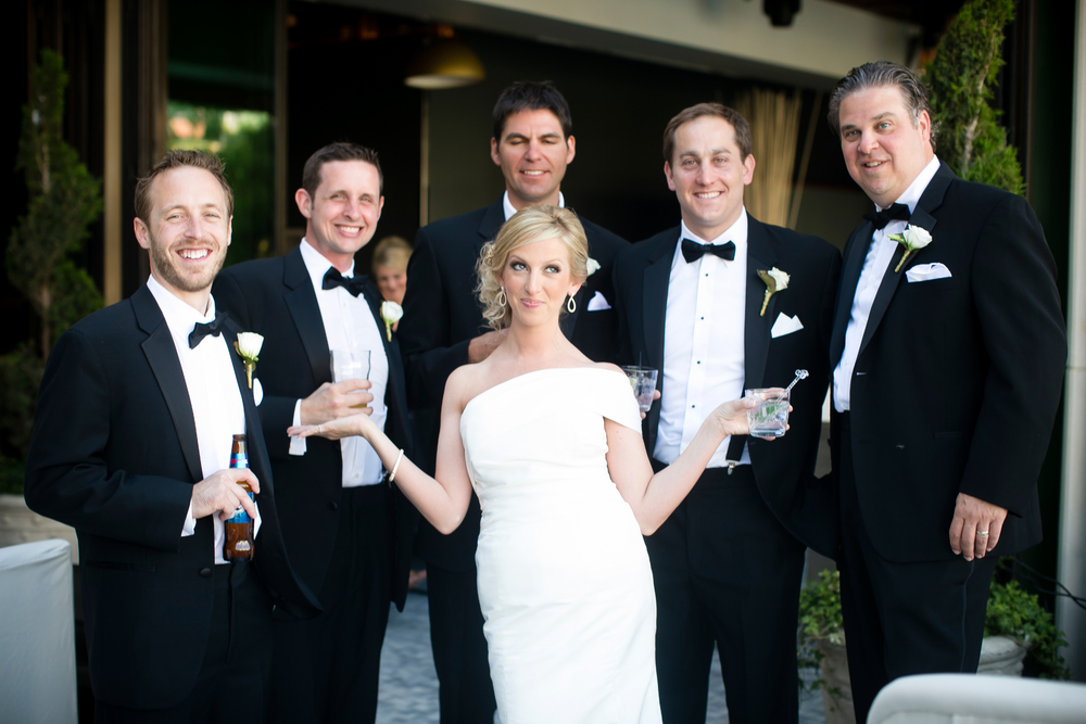 Marci getting cheeky with the groomsmen over a cocktail.  Wedding Venue:  Bellagio Las Vegas.   Location:  Hyde Bellagio .  Photo by  www.ronmiller.com .  Las Vegas Wedding Planner:  Andrea Eppolito Events .
