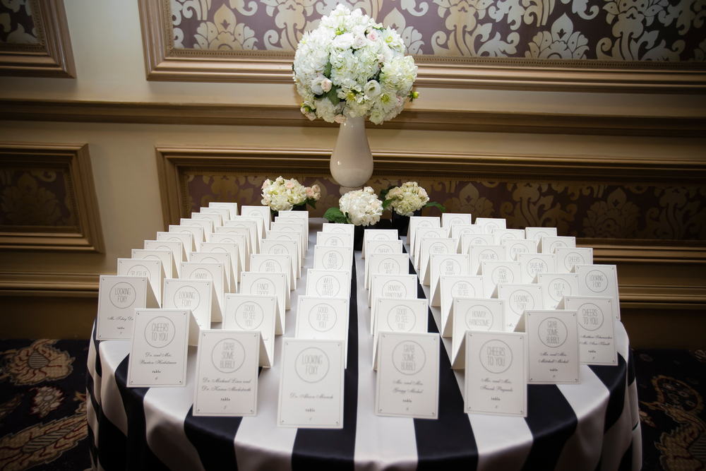 A Black And White Striped Linen Hydrangeas Roses Were Set Up Along Side The