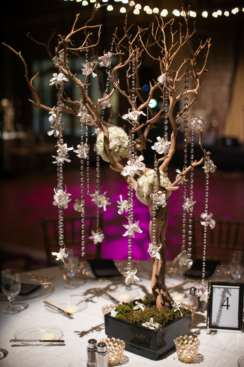 Sandblasted Manzanita Branch Centerpieces with moss, orchids, rose pomander balls,and crystals.    Wedding Venue:  Bellagio Las Vegas.   Photo by  www.ronmiller.com .  Floral & Decor:  Naakiti Floral .  Las Vegas Wedding Planner:  Andrea Eppolito Events .