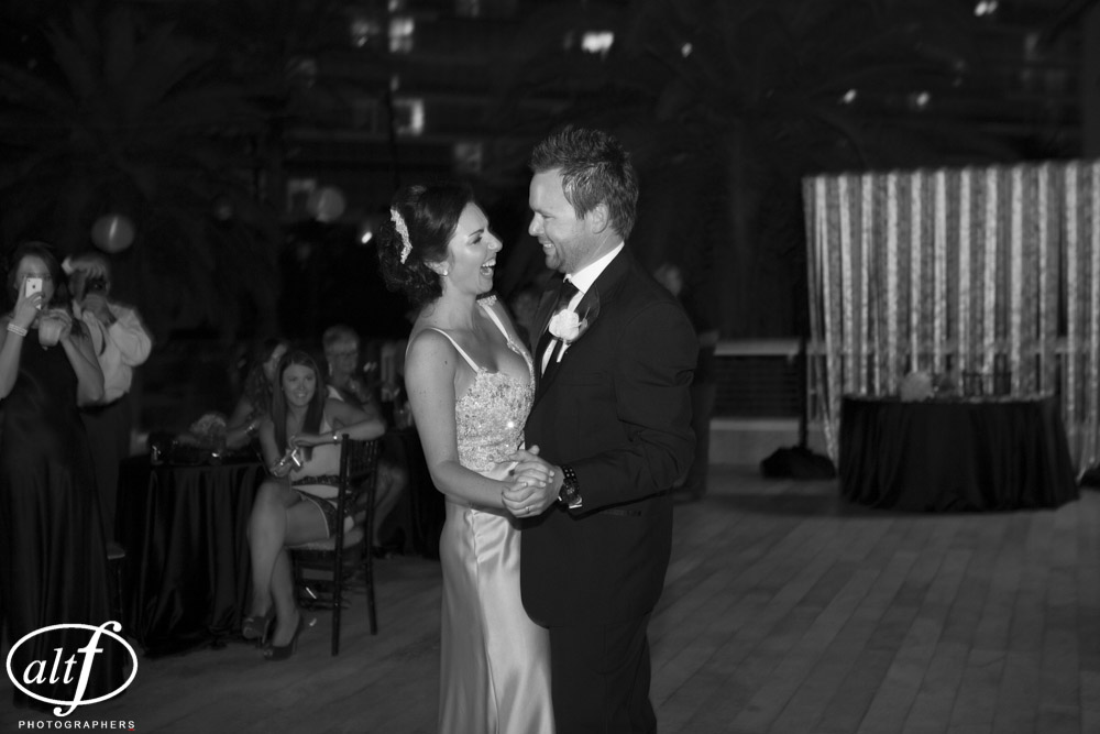 The first dance took place on the pool deck. Las Vegas Wedding Planner Andrea Eppolito Events.  LocationL Hard Rock Hotel Las Vegas.  Photography by www.altf.com.