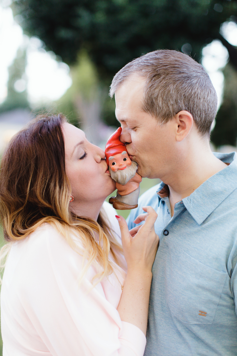 Kiss the Gnome!  They love this little guy and take him everywhere. Practicing for a puppy, perhaps? Engagement Photos in San Diego / Coronado by Burlap and Blossom.
