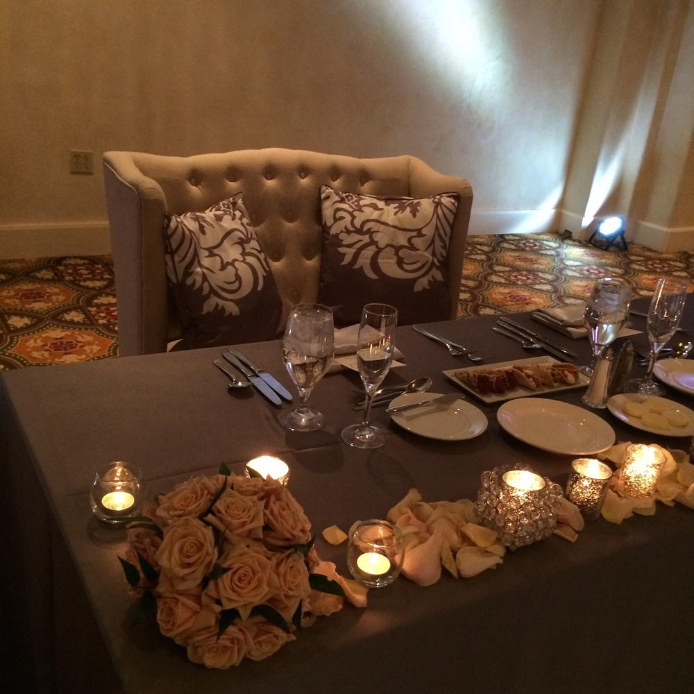 I love the couch and pillows for the sweetheart table set up.   Las Vegas Wedding Planner: Andrea Eppolito | Wedding Venue: Westin Lake Las Vegas | Wedding Dress: Cosmobella | Floral and Decor: Naakiti Floral