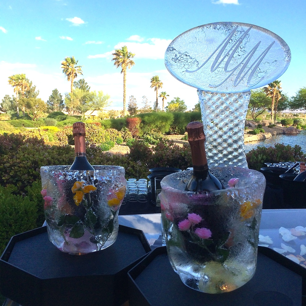 Ice buckets with frozen flowers gave a soft, feminine touch to the Bubbles and Bourbon Bar.