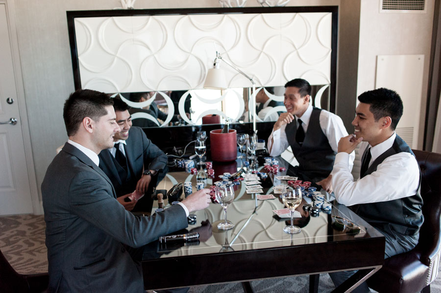 While the bride got ready, the groom played a hand of poker with his men in the suite. Las Vegas Wedding Planner Andrea Eppolito.  Wedding at Four Seasons.  Photography by Meg Ruth.  Floral and Decor by Naakiti Floral.