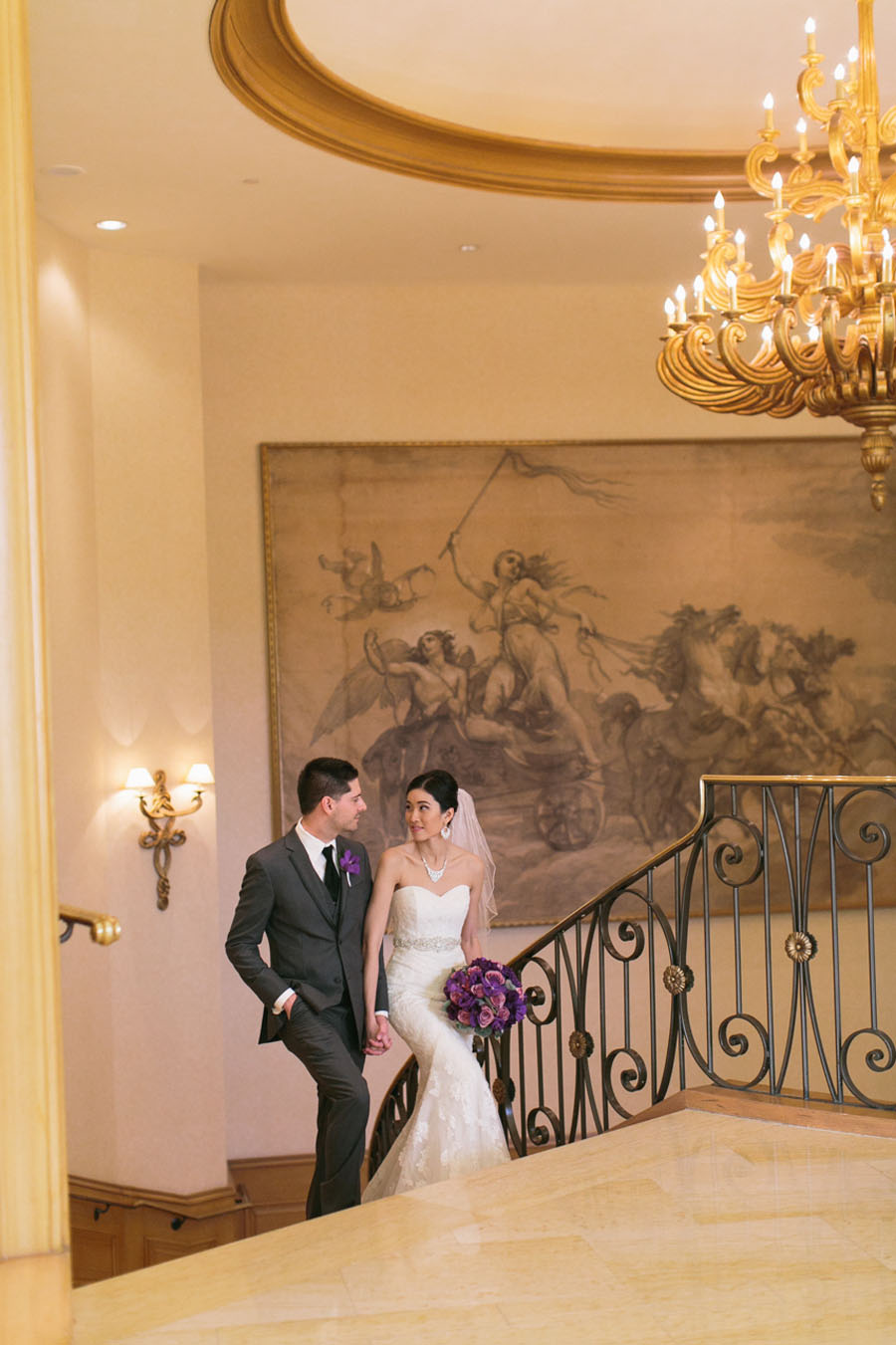 Katherine and Jared took a walk on The Four Seasons staircase.   Las Vegas Wedding Planner Andrea Eppolito.  Wedding at Four Seasons.  Photography by Meg Ruth.  Floral and Decor by Naakiti Floral.
