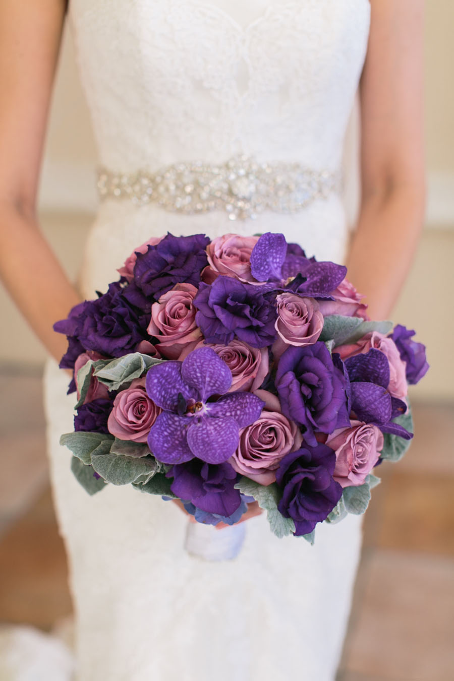 The Bridal Bouquet of Roses and Orchids. Las Vegas Wedding Planner Andrea Eppolito.  Wedding at Four Seasons.  Photography by Meg Ruth.  Floral and Decor by Naakiti Floral.