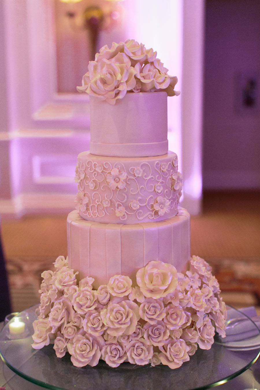 Four Tier Wedding Cake decorated with hand crafted, iridescent sugar flowers.  Katherine & Jared - Wedding at the Acacia Ballroom at the Four Seasons Las Vegas.   Las Vegas Wedding Planner Andrea Eppolito.  Wedding at Four Seasons.  Photography by Meg Ruth.  Floral and Decor by Naakiti Floral.