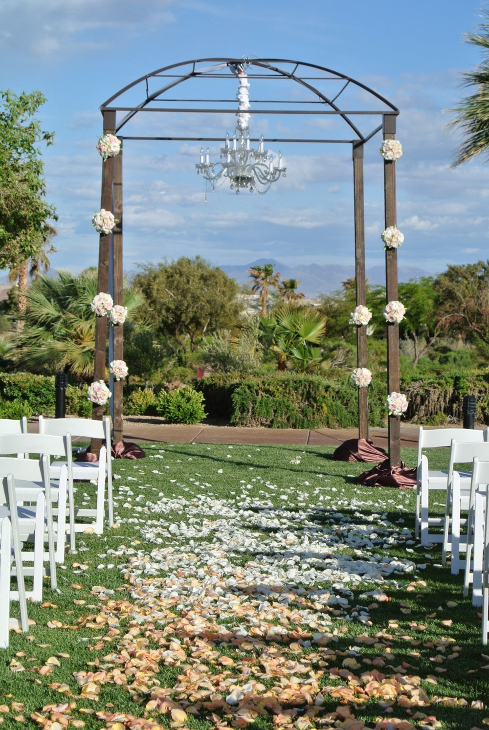 The ceremony was set up on the Siena Golf Club lawn. Photo by Andrea Eppolito. Las Vegas Wedding Planner Andrea Eppolito |  Las Vegas Venue: Siena Golf Course | Floral & Decor: Naakiti Floral & Sit On This