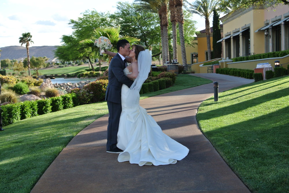 Michelle & Michael share a private moment after their Las Vegas wedding at Siena Golf Club.  Photo by Andrea Eppolito.