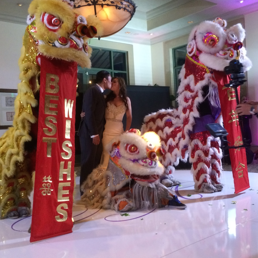 Celebrating with the lions of the Las Vegas Kung Fu Academy.  Photo by Andrea Eppolito. Las Vegas Wedding Planner Andrea Eppolito | Las Vegas Venue: Siena Golf Course |  Floral & Decor: Naakiti Floral and Sit On This