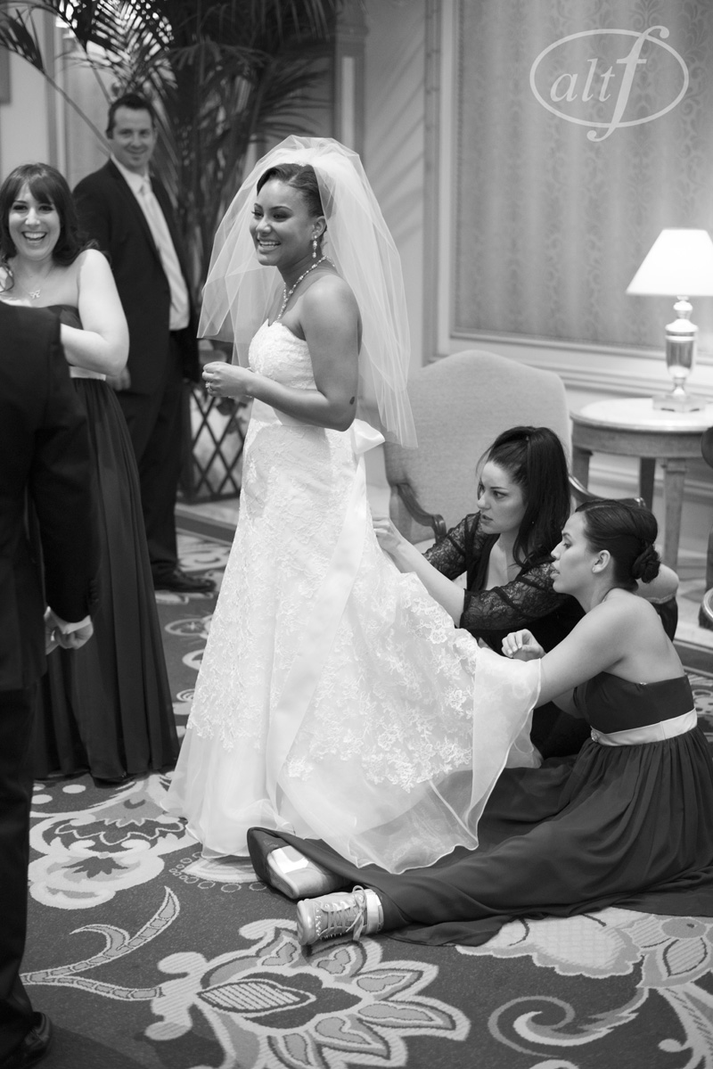 Las Vegas Wedding Planner Andrea Eppolito bustling a bride's dress at her Bellagio Wedding.