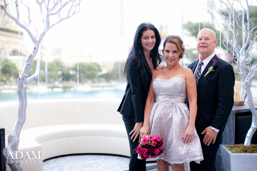 Las Vegas Wedding Planner Andrea Eppolito celebrating with a newly married couple who's wedding had just taken place at Hyde Bellagio.