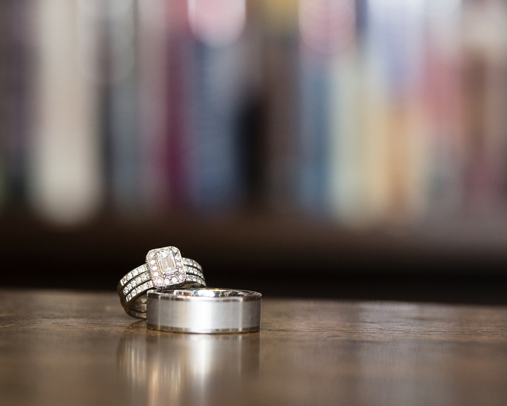 The bride's emerald cut engagement ring and pave wedding bands were bound together, and sat on top of the groom's platinum band.    Destination Wedding Planner:   Andrea Eppolito Events   |  Historical Wedding Venue:   The Arizona Inn   |  Photography:  Raylene Streuber