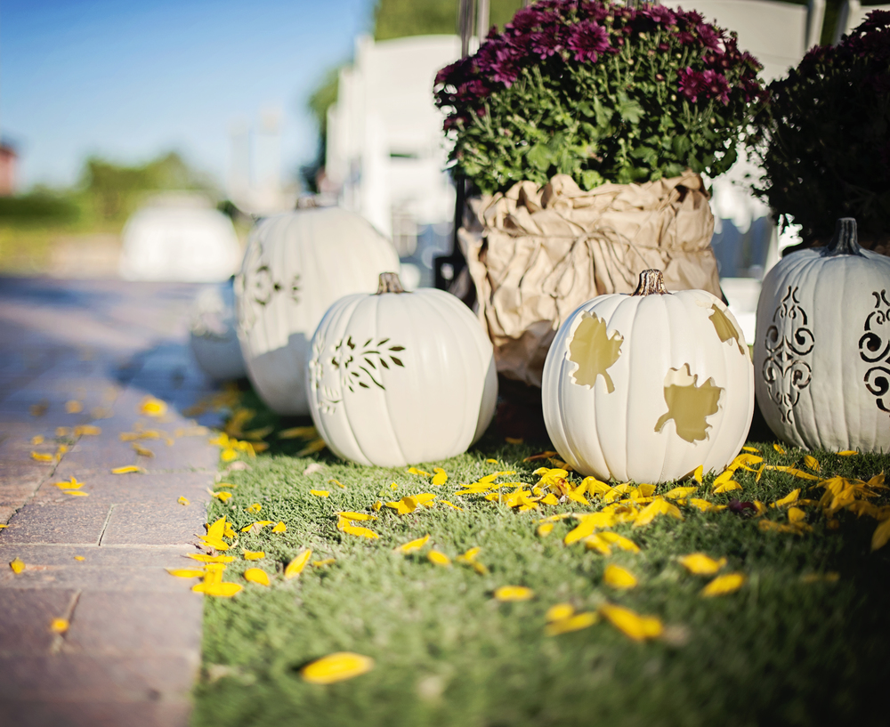 Hand carved pumpkins were painted white for an elegant nod to the fall season.    Destination Wedding Planner:   Andrea Eppolito Events   |  Historical Wedding Venue:   The Arizona Inn   |  Photography:  Raylene Streuber  |  Wedding Florist:   In Full Bloom