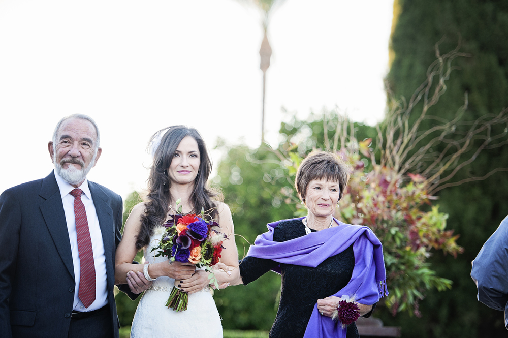 The bride was given away by her mom and dad.   Destination Wedding Planner:   Andrea Eppolito Events   |  Historical Wedding Venue:   The Arizona Inn   |  Photography:  Raylene Streuber