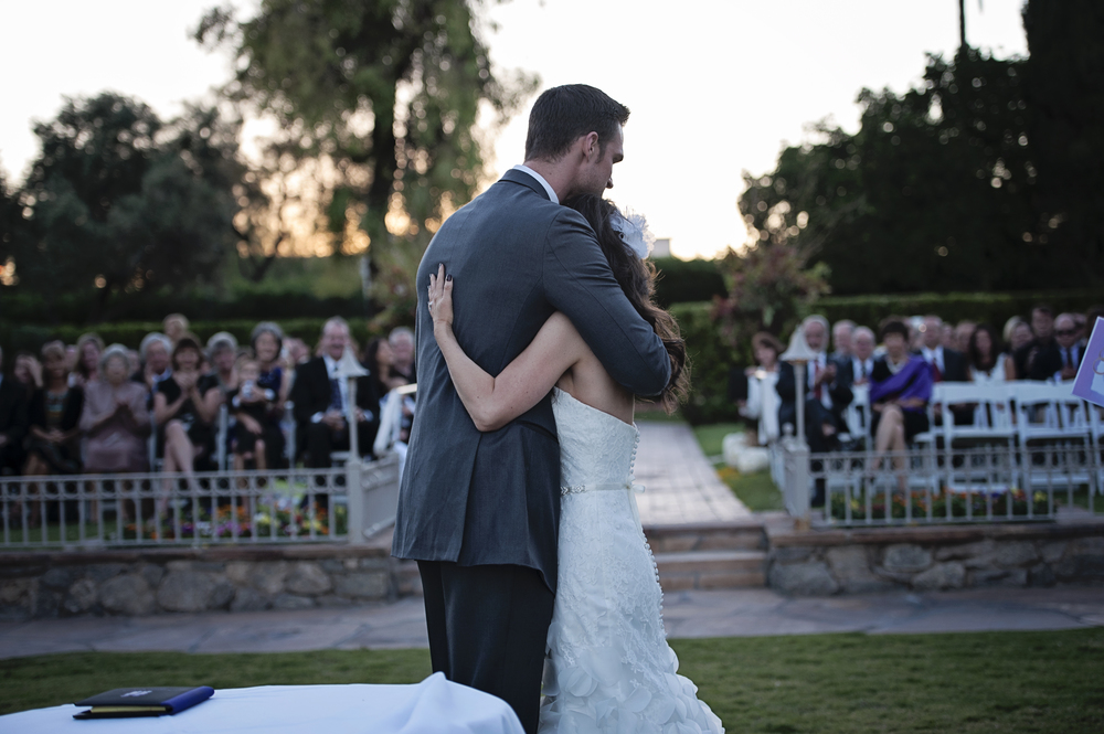 Taking it in after their first kiss.    Destination Wedding Planner:   Andrea Eppolito Events   |  Historical Wedding Venue:   The Arizona Inn   |  Photography:  Raylene Streuber