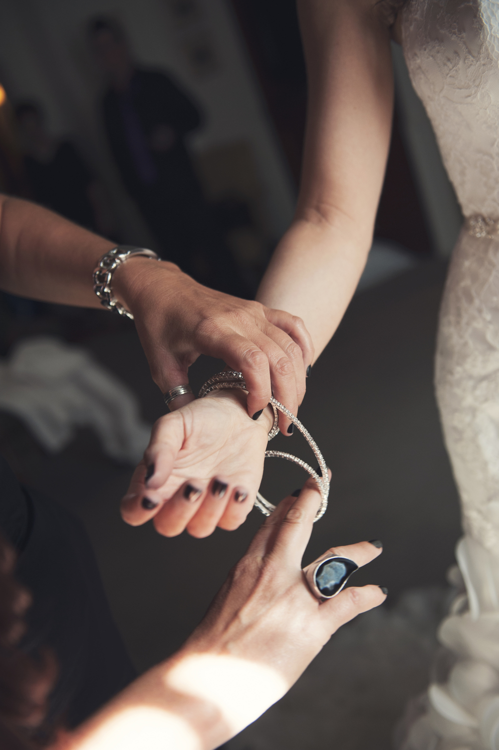 Bridal Bracelet.  Putting on the final touches.    Destination Wedding Planner:   Andrea Eppolito Events   |  Historical Wedding Venue:   The Arizona Inn   |  Photography:  Raylene Streuber