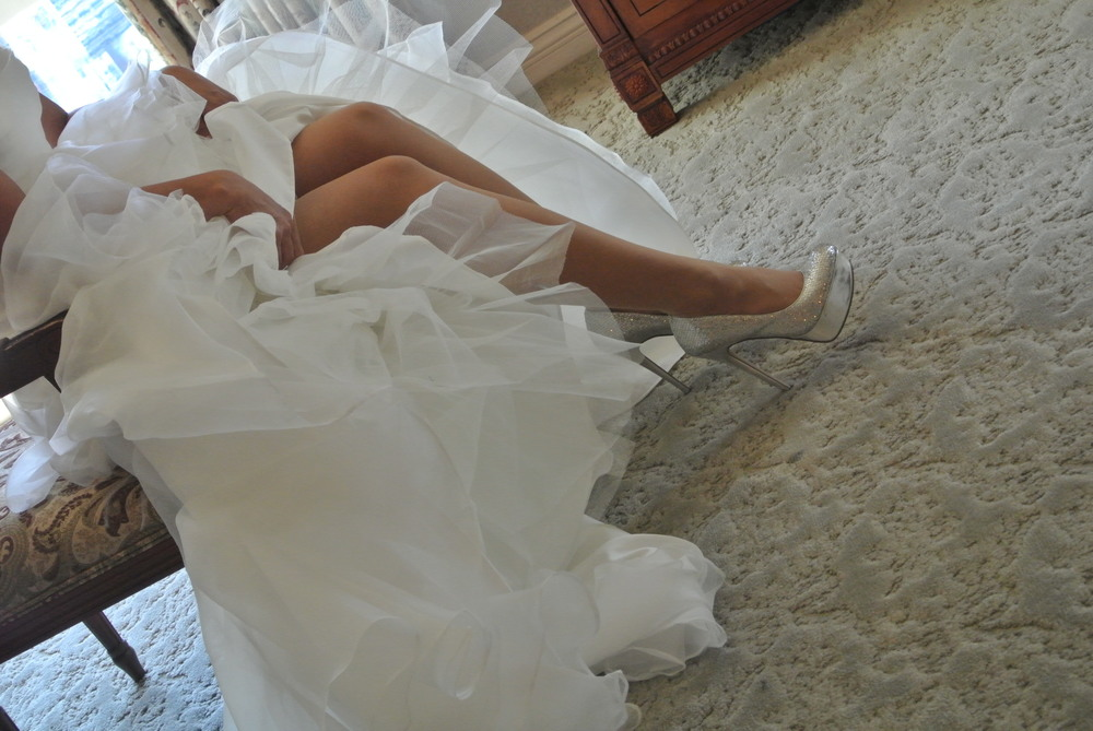 Can we talk about the bride's legs for a moment?  Totally unintential but very sexy shot!  Photo by Las Vegas Wedding Planner Andrea Eppolito.
