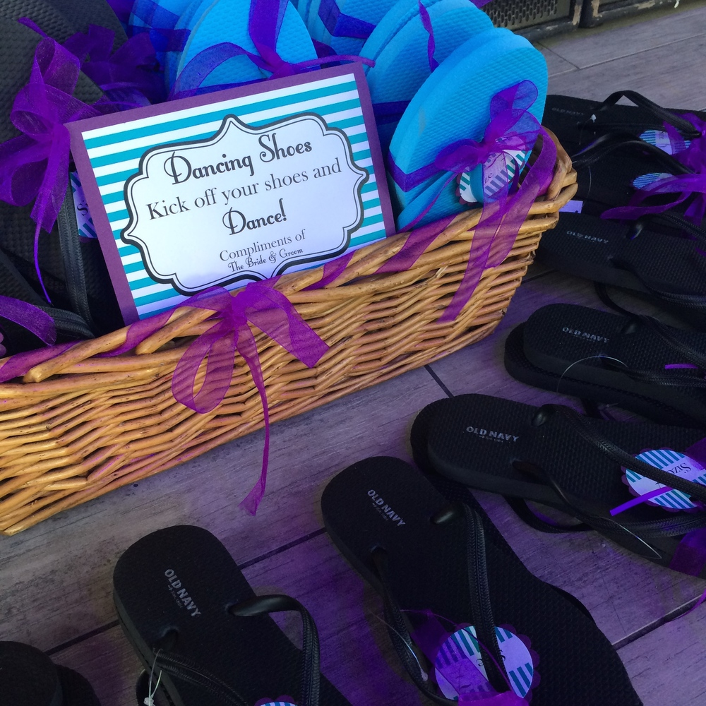 Personalized flip flops in black, blue, and purple.  Photo by Las Vegas Wedding Planner Andrea Eppolito.