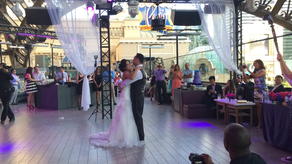 With the photographer to the left and the videographer to the right, we captured every angle of the first dance!  Photo by Las Vegas Wedding Planner Andrea Eppolito.