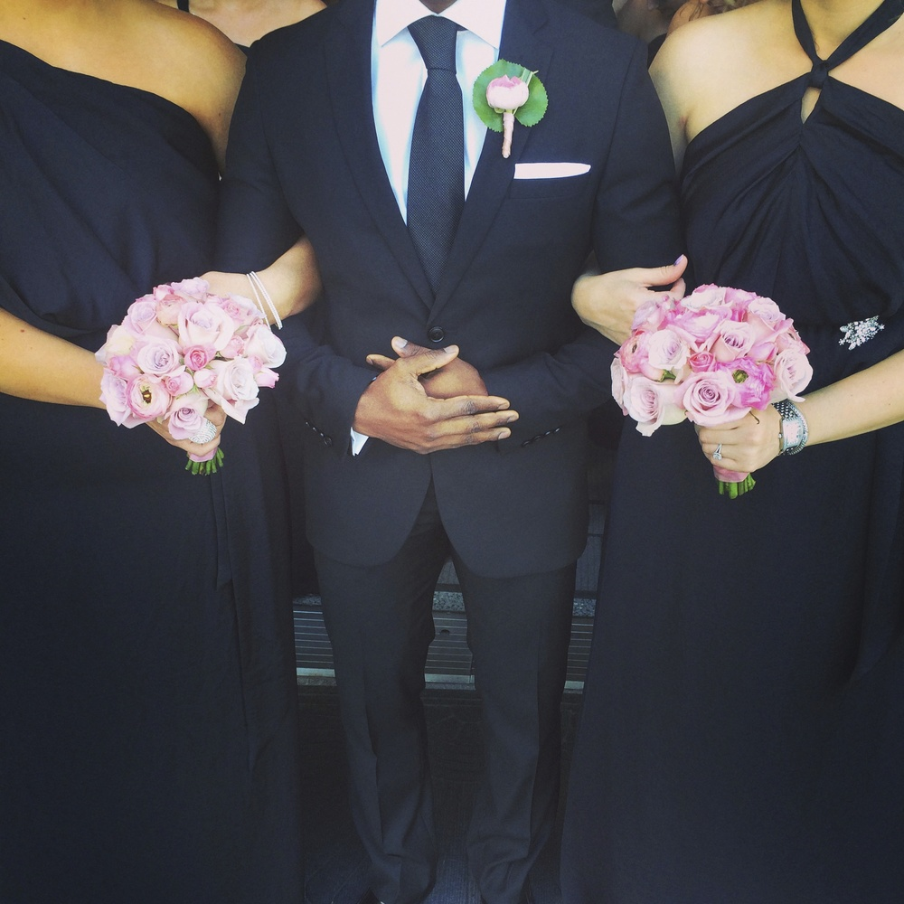 We styled out the Bridesmaids and Groomsmen with pink and lilac bouquets and boutonnières by Naakiti Floral.      Las Vegas Wedding Planner Andrea Eppolito  | Bella Bridesmaids  |  Flowers by Naakiti Floral
