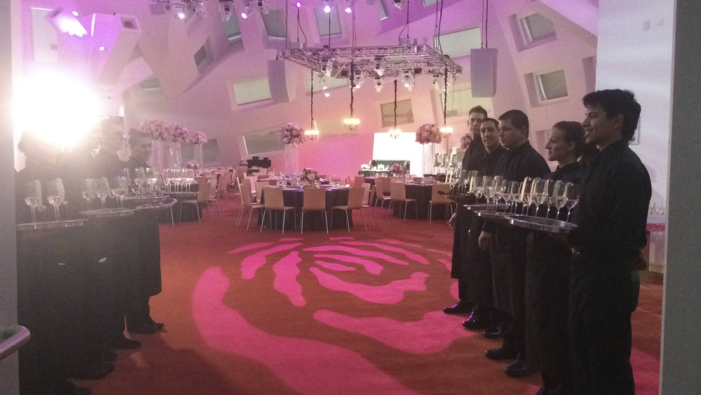 Guests were welcomed in the space by servers at the ready with glasses of champagne, each holding a scrolled escort card with their name and table assignment on it.  Las Vegas Wedding Planner Andrea Eppolito  | Escort Cards by Hi Note Stationary.