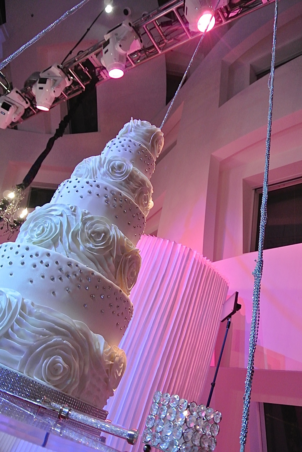 That's seven stunning towers of sugar and flour goodness!      Las Vegas Wedding Planner Andrea Eppolito  | Wedding Cake by Peridot Sweets.  Hanging by Naakiti Floral.