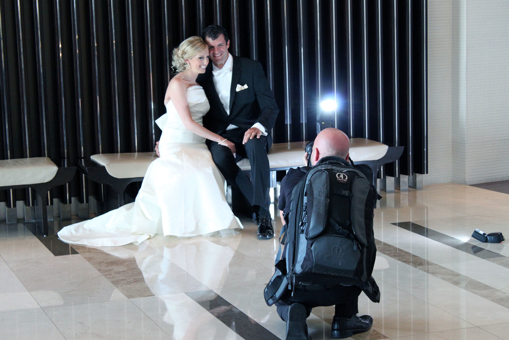 Las Vegas Wedding Photographer Ron Miller photographing Marci & Mike Pugnale at Vdara.  What perfect timing - this shot was taken just as the flash went off!  From the wedding of Marci & Mike Pugnale.