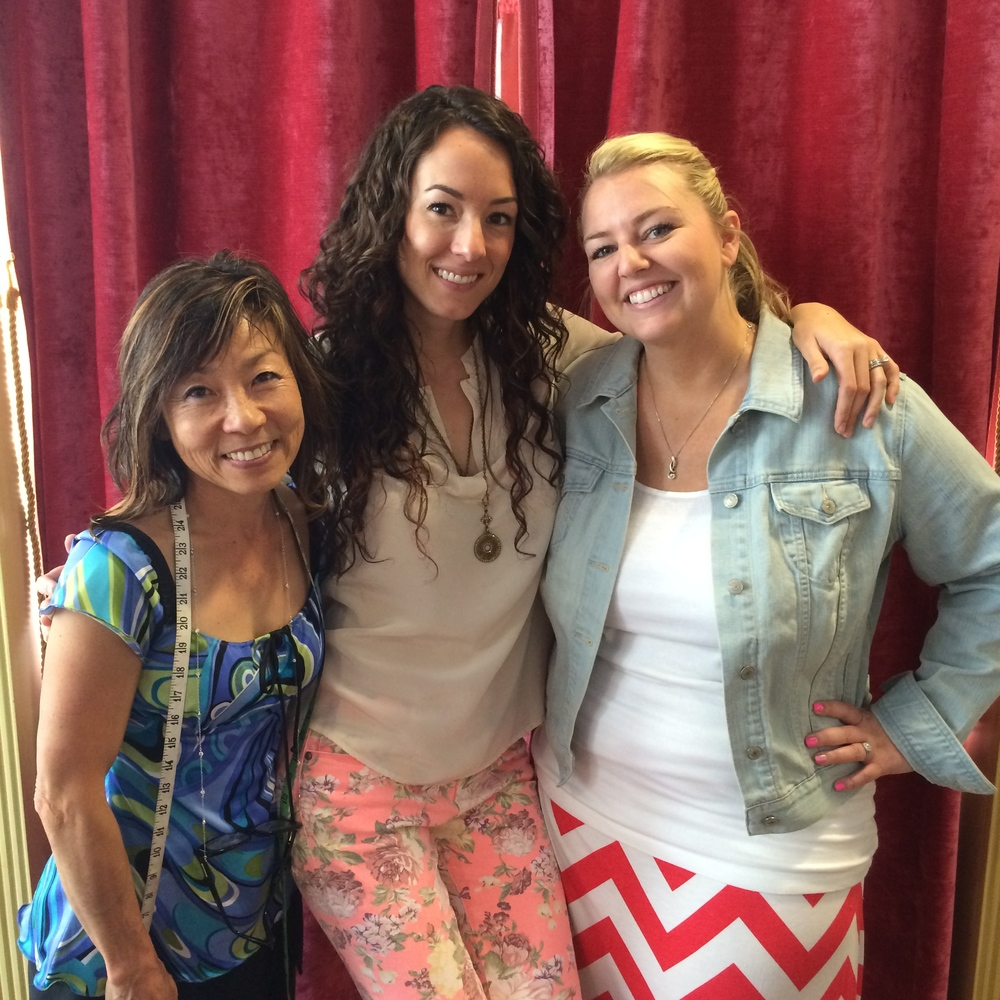 Tailor and seamstress Suki with designer Megan Thompson and bride Hayley Freeman (now Heard) at the Mina Olive showroom.