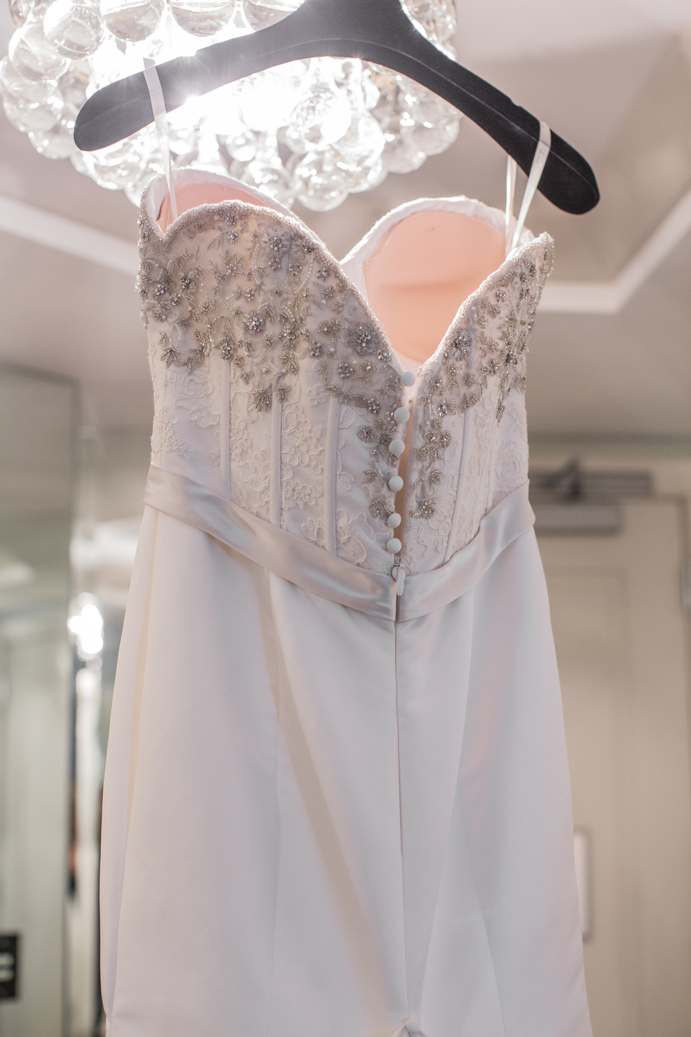 The bride's Victor Harper dress hung in their suite at the Cosmopolitan. Las Vegas Wedding at Siena Golf Club  |  Photography by Ella Gagiano  |  Las Wedding Planner Andrea Eppolito